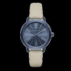 ساعة نسائية مايكل كورس هارتمان لون بحري آي بي  و حزام جلدي لون اسمنتي بثلاثة عقارب